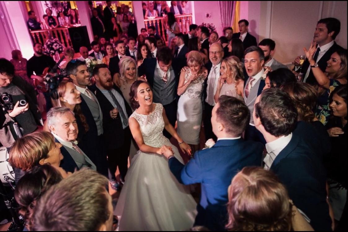 Bride & Groom dancing with their guests at their midweek wedding