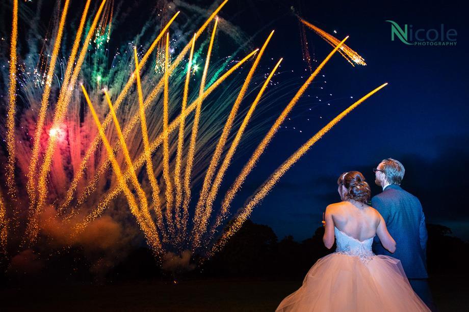 Bride & Groom watching fireworks at their midweek wedding