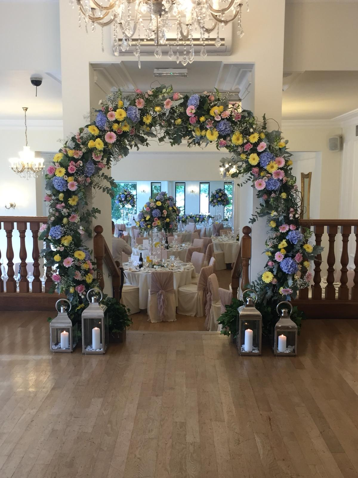 Floral arch in the Ballroom at West Tower on a midweek wedding day